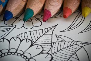 Colored pencils and blank coloring page