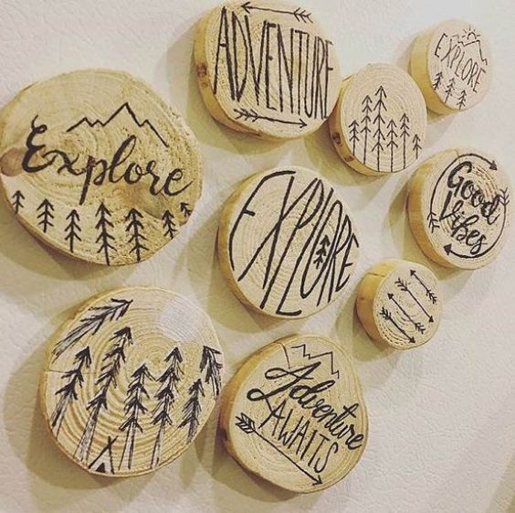 Wood pendants that have been burned to create different art and sayings.