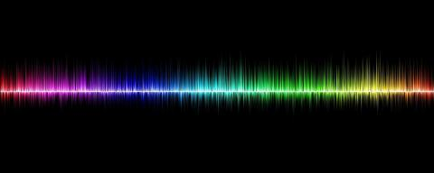 Black background with rainbow-colored soundwaves